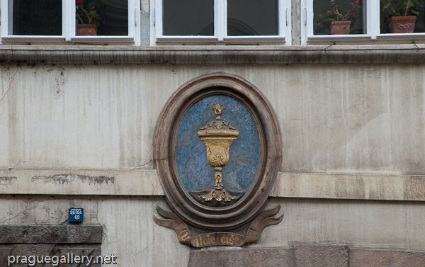 Detail of the Golden Cup house sign at N. 16 of Nerudova